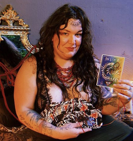 Ylva holds the Living Altar Oracle Deck